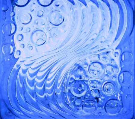 water stained: a bright blue glass tile with twirls and bubbles Stock Photo
