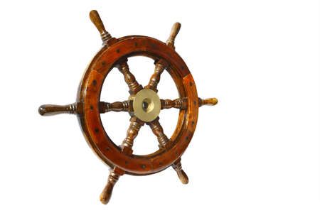 a very  old brown boat steering wheel