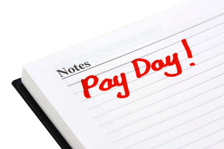 monthly salary: pay date written in a  diary on white background Stock Photo