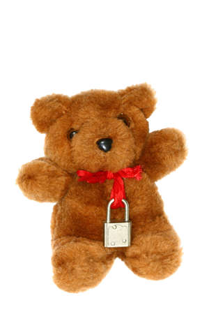 teddy bear with lock around its neck photo