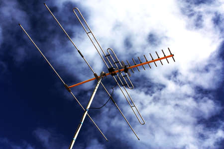 TV aerial with blue and cloudy sky Stock Photo - 7678186