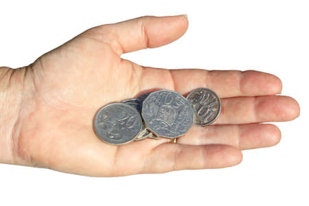 a hand holding some coins on white background photo