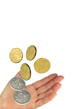 coins falling into a hand on white background photo