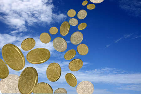 a lot of coins faling from a blue cloudy  sky photo