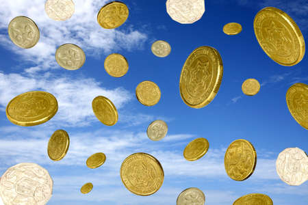 falling money: coins  falling from a blue sky with clouds
