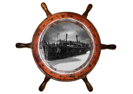 boat wheel with shipwreck inside on white background photo