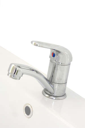 a hand basin tap on a white background photo