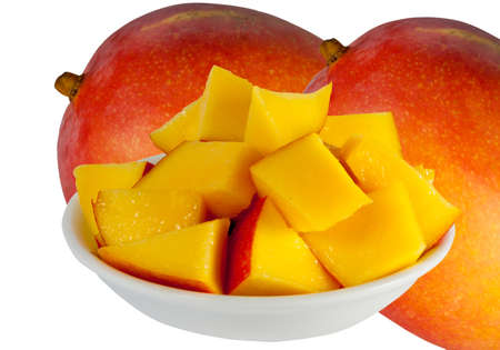 cubed: two whole mango and cubed on a plate Stock Photo