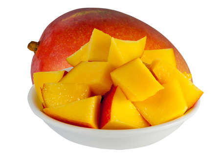 cubed: freshly cut cubed mango on a plate