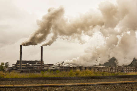 smoke stack: smog and pollution coming from a sugar mill