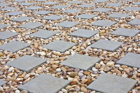 empedrado: cuadrados de pavimentación con piedras pequeñas en el medio