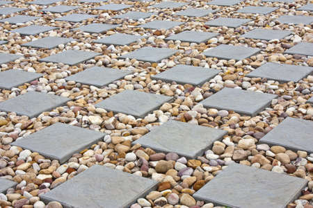square paving with small stones in between