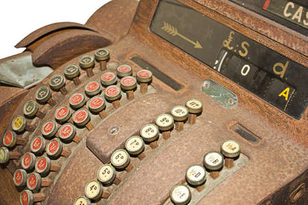 an old cash register on a white background photo