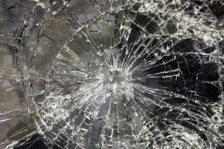 a large glass pane  broken in pieces photo