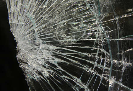 window pane: broken or smashed glass on a black background