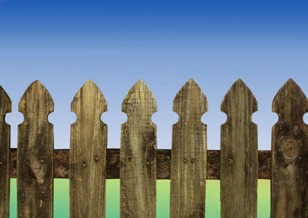 close up of an old fence with blue and green background photo