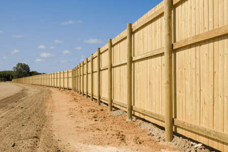 a long new fence on new property development photo