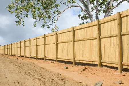fence panel: a long fence in a new housing development