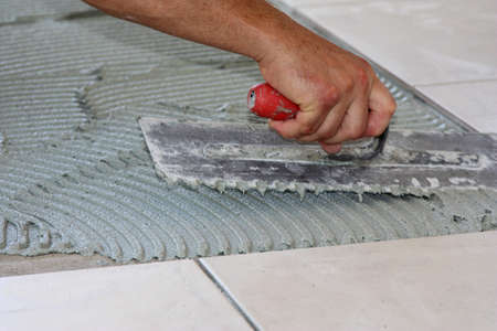 renovating and re-tiling the laundry floor Stock Photo