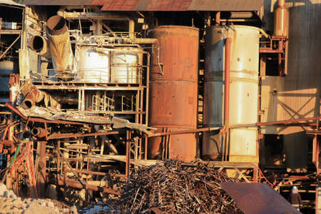 dismantling: demolishing the old sugar mill at Tully North Queensland Australia