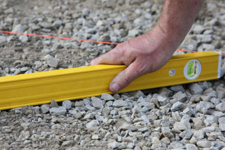 leveling: preparing and leveling the ground for paving