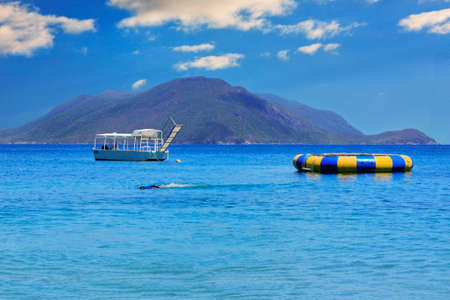 Beautiful blue waters of Fitzory Island and surroundings photo