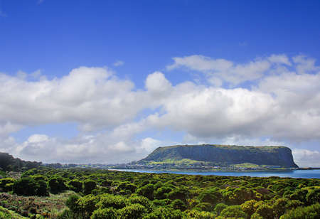 geological feature: The Nut is a 152 metre high geological feature, the core of an extinct volcano, looming above the village of Stanley