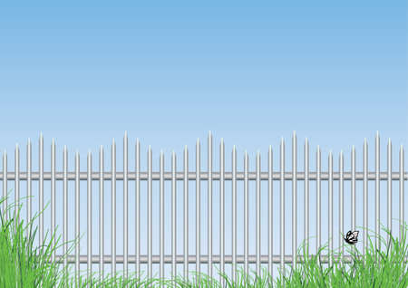 paling: steel fence and grass in the foreground with blue background