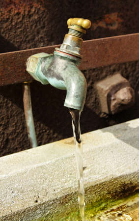 an outside dripping tape wasting precious water photo