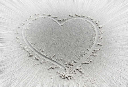 heart in sand: heart shape in the sand with rays  around Stock Photo