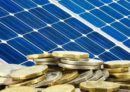 power of money: close up of solar panel and money saving