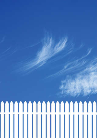 white picket  fence with a blue sky