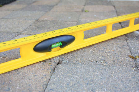 pavers: spirit level used to level the pavers or bricks