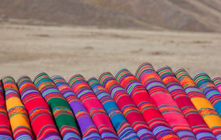colorful fabric being sold on the roadside