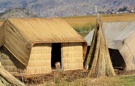 navigable: close up of hut on floating Uros islands on Lake Titicaca Peru which is 3800 meters above sea level, highest navigable lake in the world Stock Photo