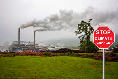 greenhouse gas: factory with smog and stop sign Stock Photo