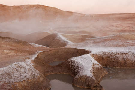 craters: early morning view of the smoking craters in a lunar type landscape in Bolivia Stock Photo