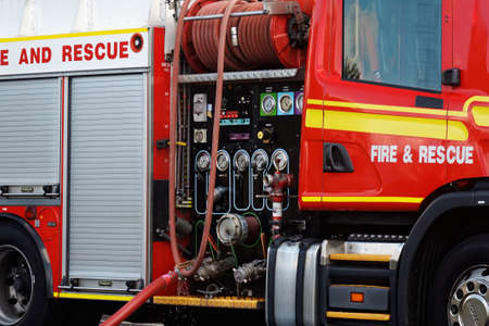 fire engine: a close up of red fire engine and its equipment
