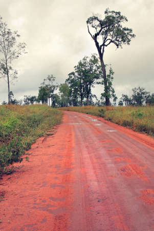 overcast: red dirt road in Australia on overcast  and rainy day
