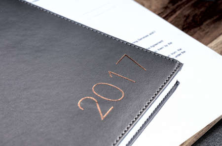 diaries: business 2017 diary on a wooden table