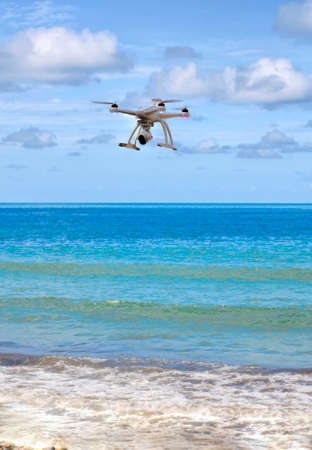 electronic survey: drone with camera  hovering over the sea