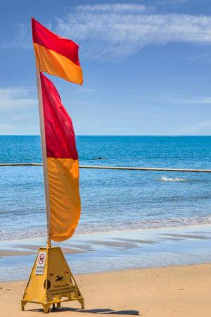one life saving warning sign flag on the beach Stock Photo