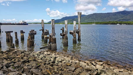 view from Cairns pier of Trinity inlet with ruined post in forground Stock Photo
