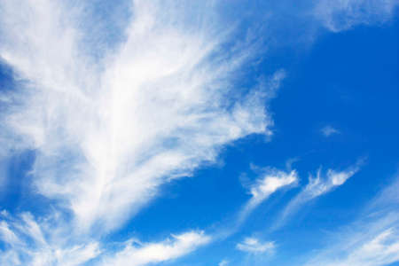 nebulous: blue sky with striking clouds Stock Photo