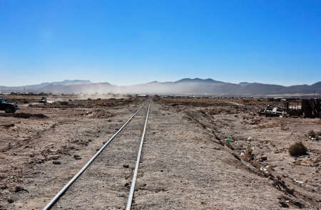 abandonment: Bolivia old railway in the dry arid desert