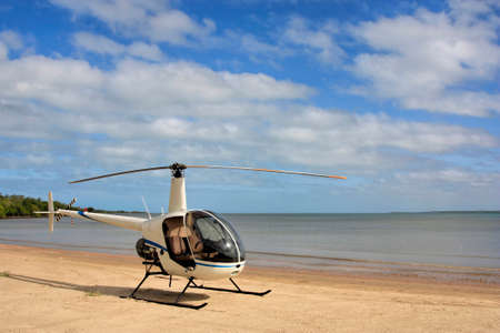 helicopter on the beach at Weipa North Queensland Australia Stock Photo