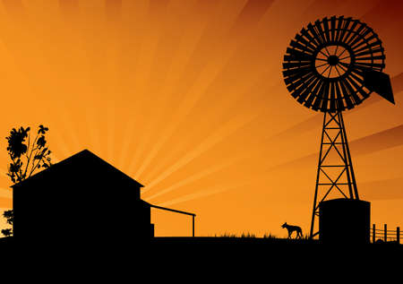Outback Australia silhouette scene of farm house and windmill