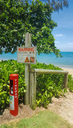 warning sign for marine stingers and crocodiles at the beach at Cairns Queensland Australia