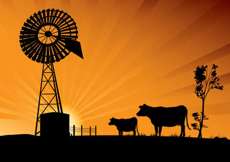 Australian windmill and cows in the outback
