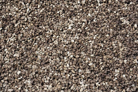 A closeup of a pile of loose rough brown stones or aggregate,abstract pattern which is well usable for backgrounds and textures